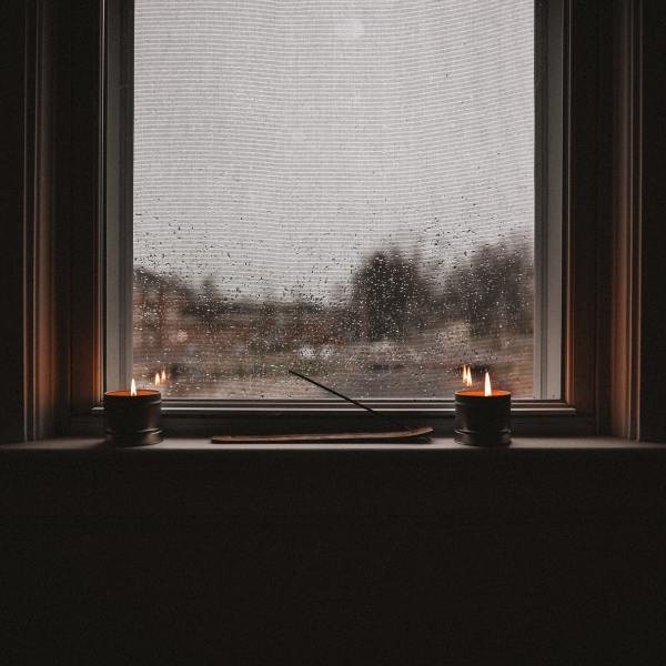 Candles lit in window